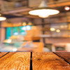 36721417 - empty wood table and coffee shop blur background with bokeh image.